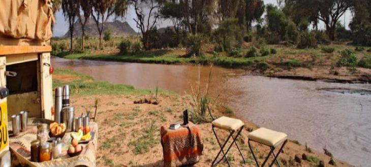 Archers post river bank